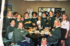 primary students posing for a group photo in the cafeteria