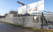 the praz-dagoud campus in the early stages of constructions with scaffolding surrounding a concrete structure.