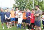 a photo of the students vs staff football game
