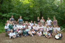 a dated photo from 2008 showing primary students in the forest